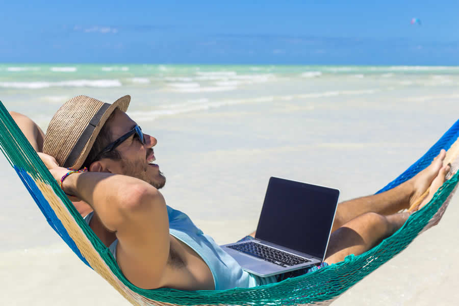 a digital nomad in asia working while in a hammock